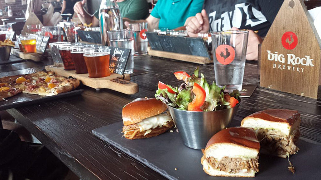 Table with Pulled Pork Sandwiches and Beer flights at Big Rock Brewery
