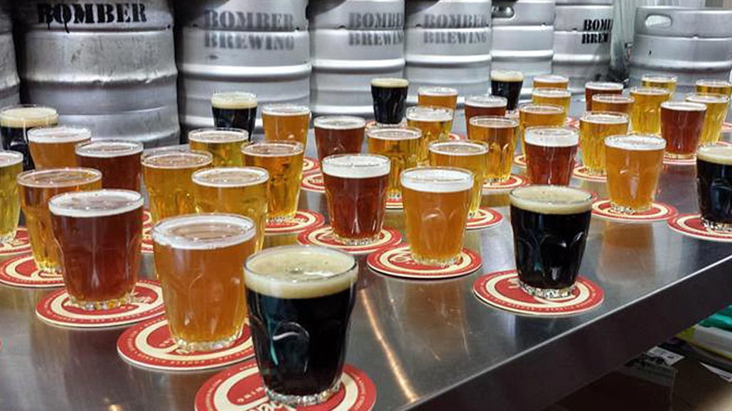 Selection of craft beer flights during a craft beer tour at Bomber Brewing Vancouver