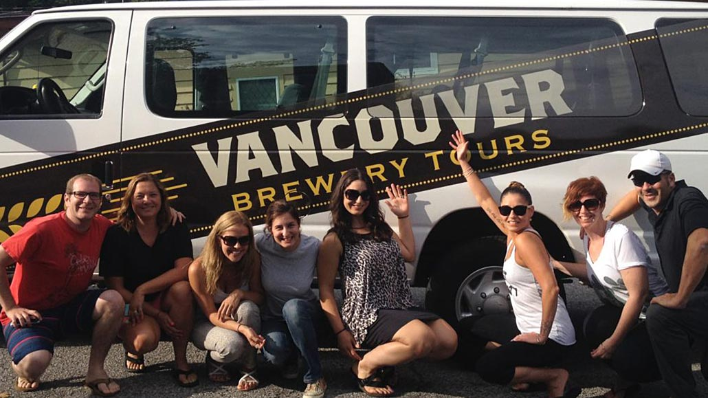 Hapy group of people in front of a Vancouver Brewery Tours Van