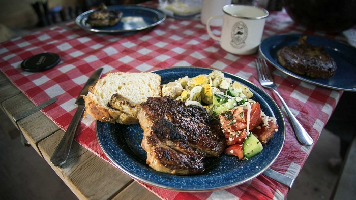 Cowboy supper with salad and steak on a table