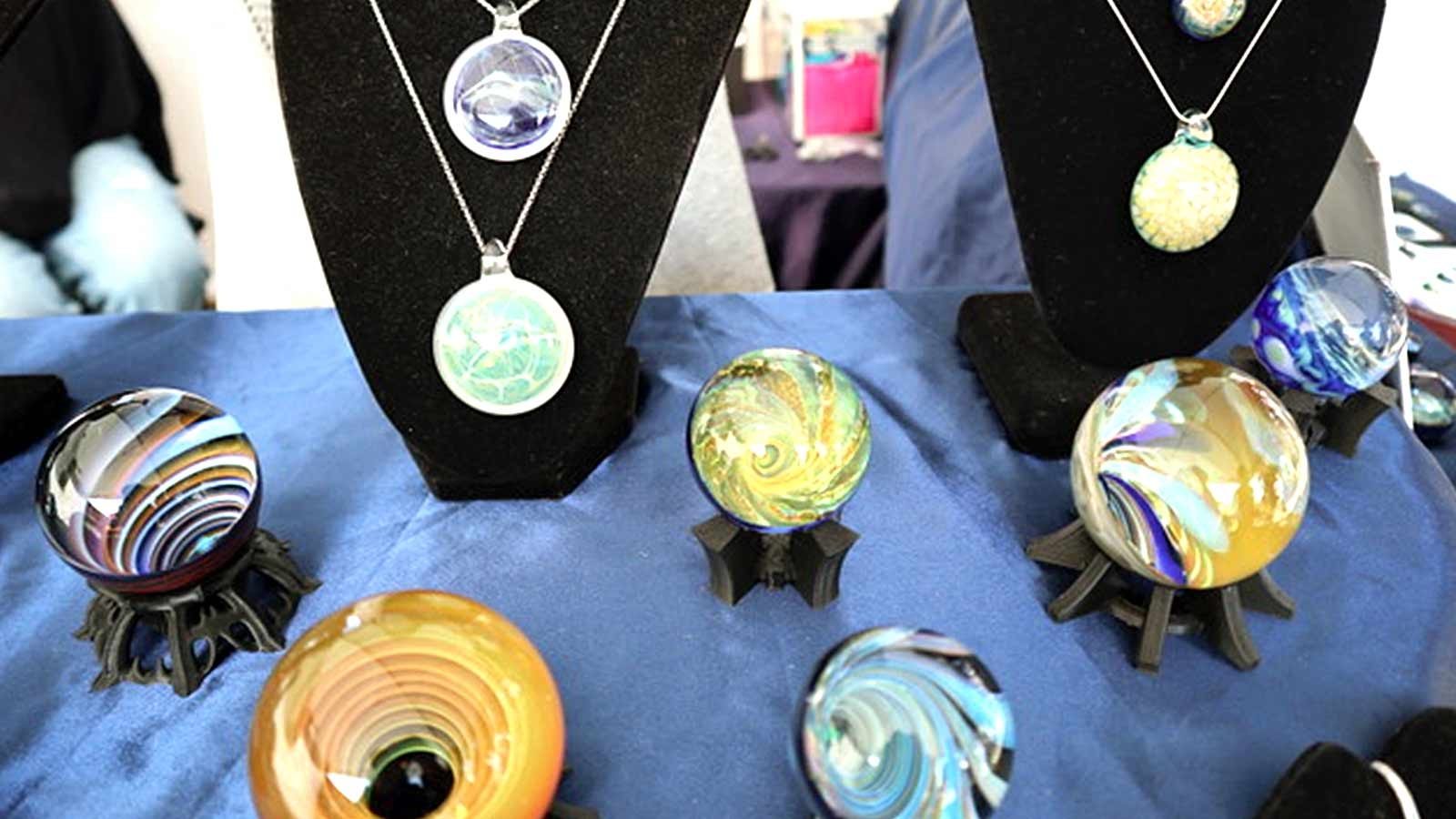 Colourful glass & jewelry art at Saturday Market at Salt Spring Island BC Canada