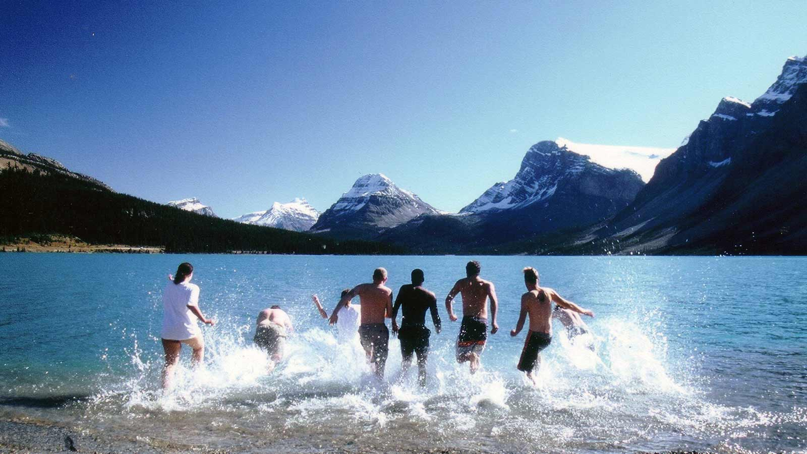Groups of people running into Bow Lake Canada