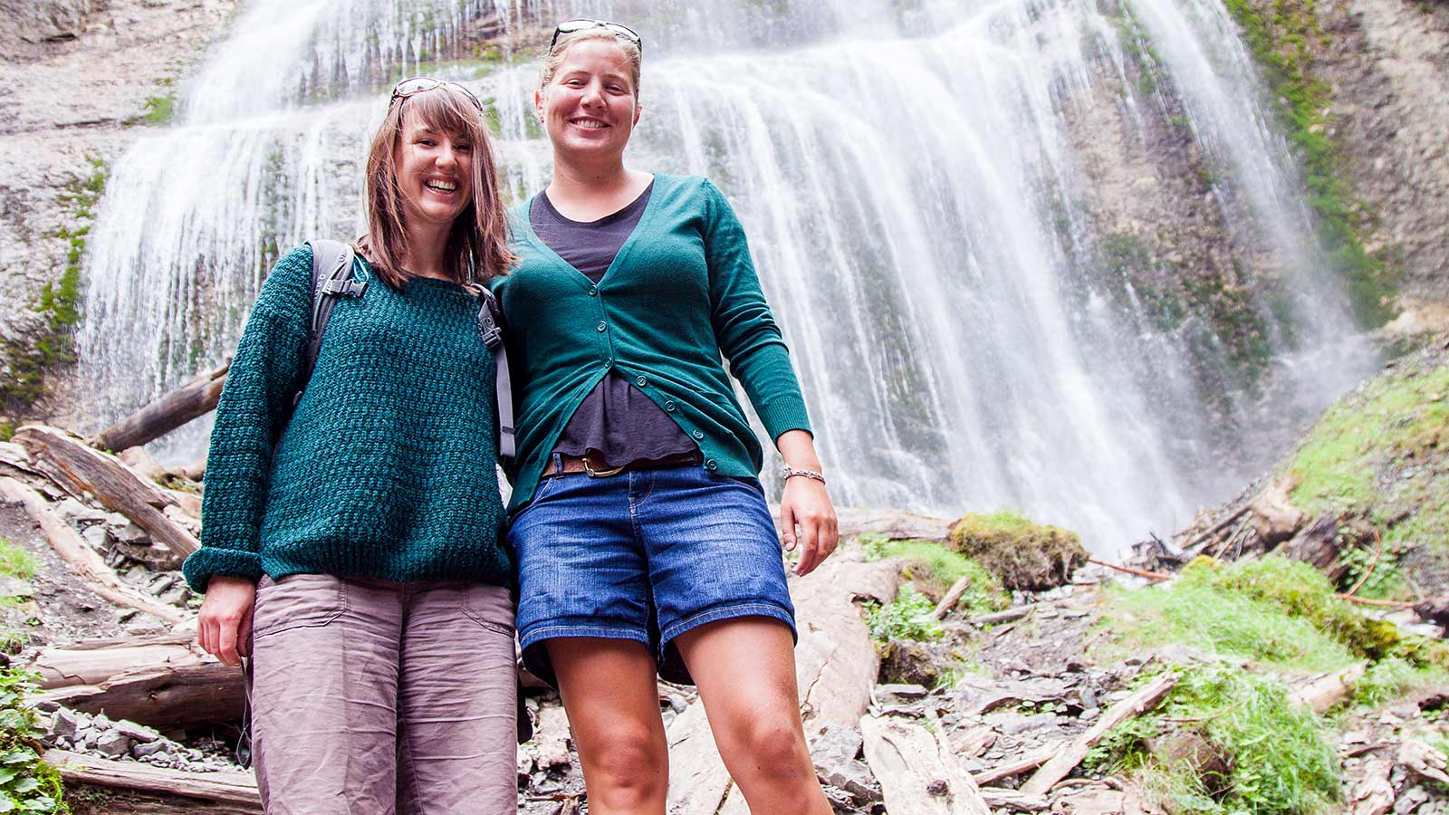 Two women standing in front of bridal veil falls near Hope British Columbia Canada